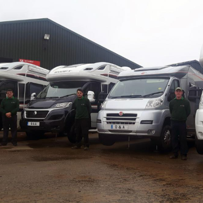 Image of motorhomes and employees